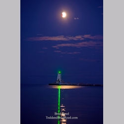 Eclipse With Ludington Lighthouse Shore Light (6644)